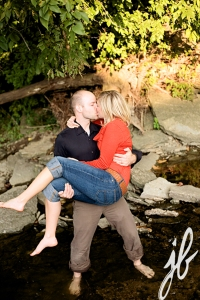 Kissing in a rocky stream takes hard work!